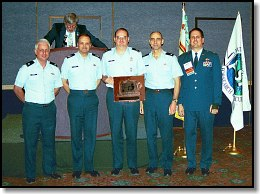 Hall Foss Award 2003 to AFRCC - Mike Tuttle (President of NASAR) at Podium, (L to R) Lt. Col. Scott Morgan (Commander, Air Force Rescue Coordination Center), MSgt. Scott Mounger, Maj. Allan Knox, Lt. Col. Roland Dixon, Maj. Paul David Meek