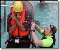 Brian Horner of Learn To Return Training Systems instructs a student in the pool