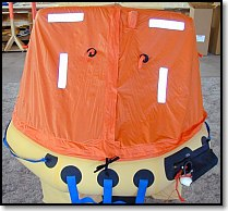 Life raft with canopy closed