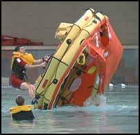 Coast Guard's Senior Rescue Swimmer demos righting a life raft