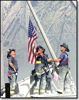 Firemen Rainsing The Flag Over Destroyed World Trade Center